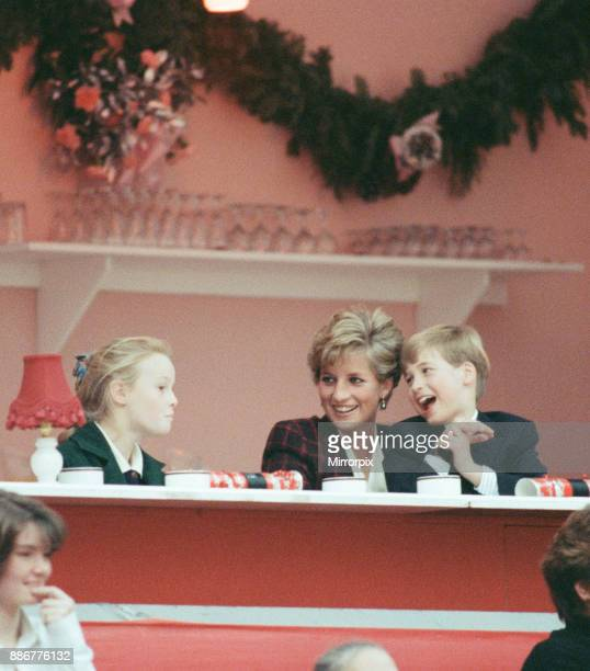 HRH Princess Diana The Princess of Wales with her sons Prince William and Prince Harry Prince William joking with a nearby young girl They are...