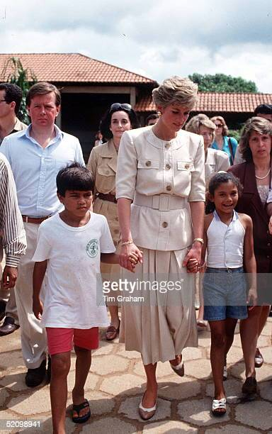Princess Diana Walking Hand In Hand With Two Pupils From The Elementary School In Carajas She Is Visiting The Princess Is Accompanied By Her Police...