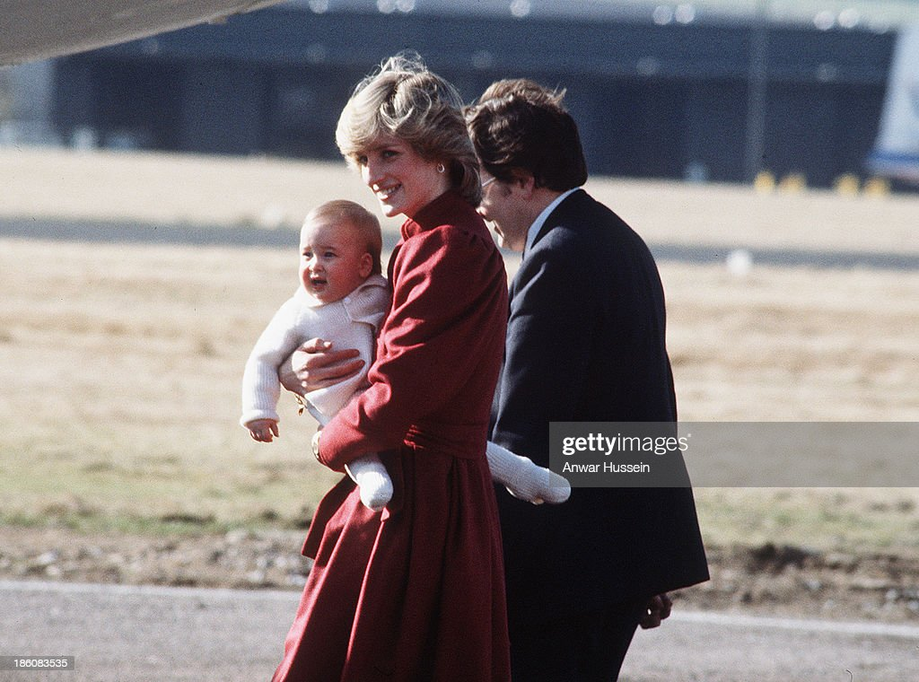 Diana Princess of Wales carries baby Prince William as she arrives at Aberdeen Airport on March 01 1983 in Aberdeen Scotland