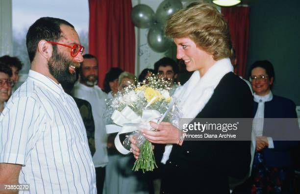 Princess Diana wearing a Catherine Walker coat dress during a visit to HIV patients at Bethnal Green Hospital London February 1989