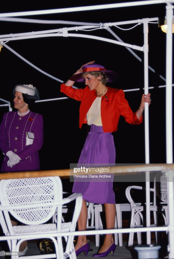 Princess Diana (1961 - 1997) wearing a Catherine Walker suit as she arrives on the Governor's launch during a visit to Hong Kong, November 1989.