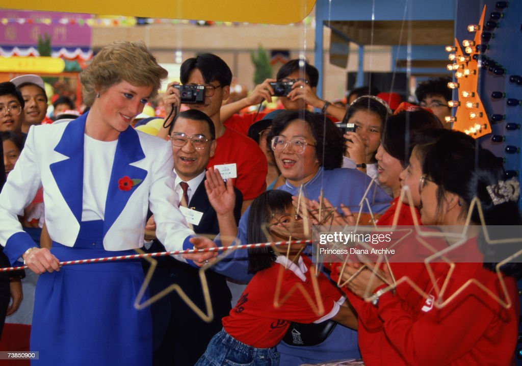 Princess Diana (1961 - 1997) wearing a Catherine Walker suit on a visit to Tuen Mun, Hong Kong, November 1989.