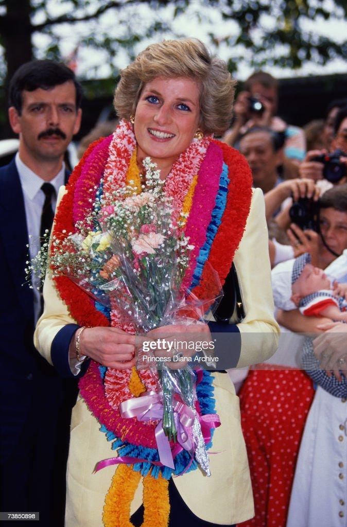 Princess Diana (1961 - 1997) wearing a garland during a visit to Hong Kong, November 1989.