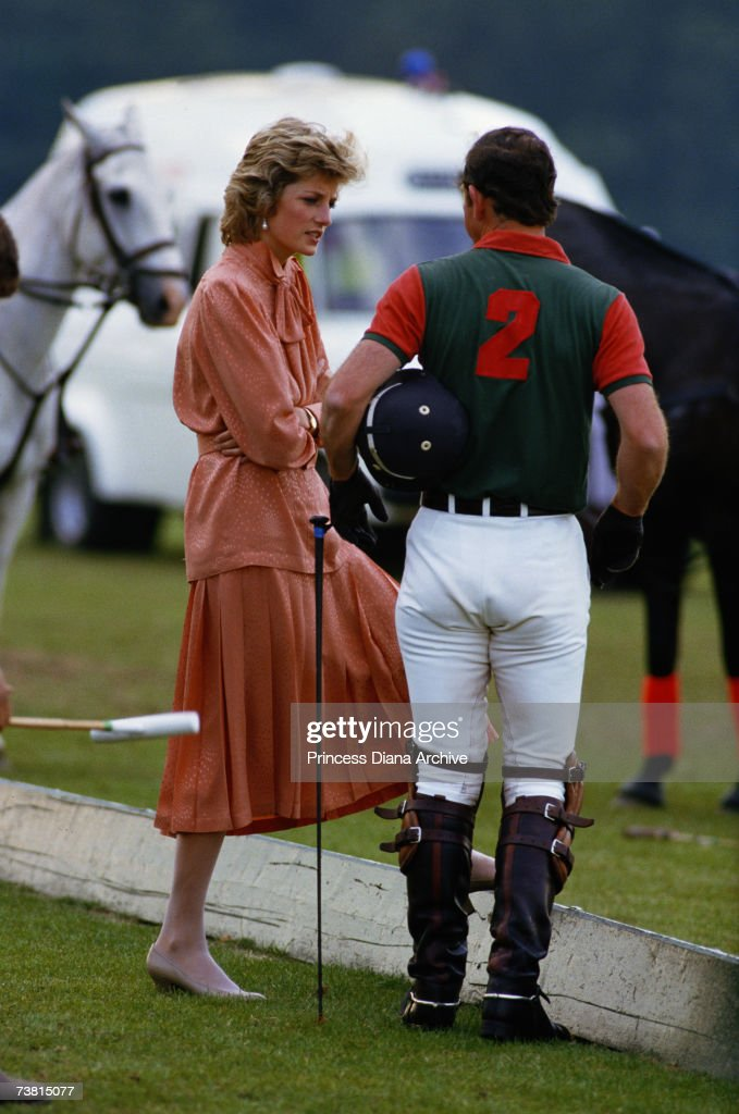 Princess Diana, wearing a Jan Van Velden suit, and Prince Charles at the Guard's Polo club, Smith's Lawn, Windsor, June 1985.