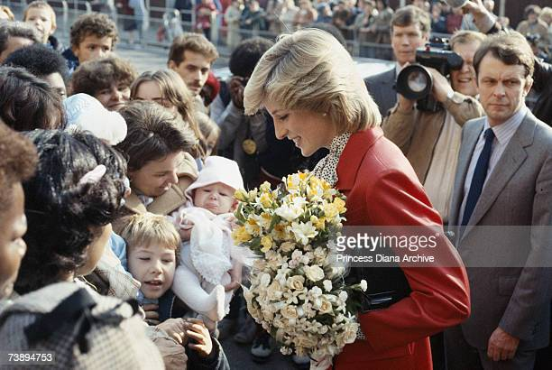 Princess Diana wearing a Jasper Conran suit during a visit to a community centre in Brixton October 1983