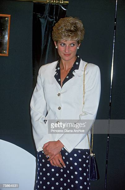 Princess Diana wearing a navy polka dot dress and white jacket during a visit to the Bruges House nursing home in Cardiff 30th June 1993