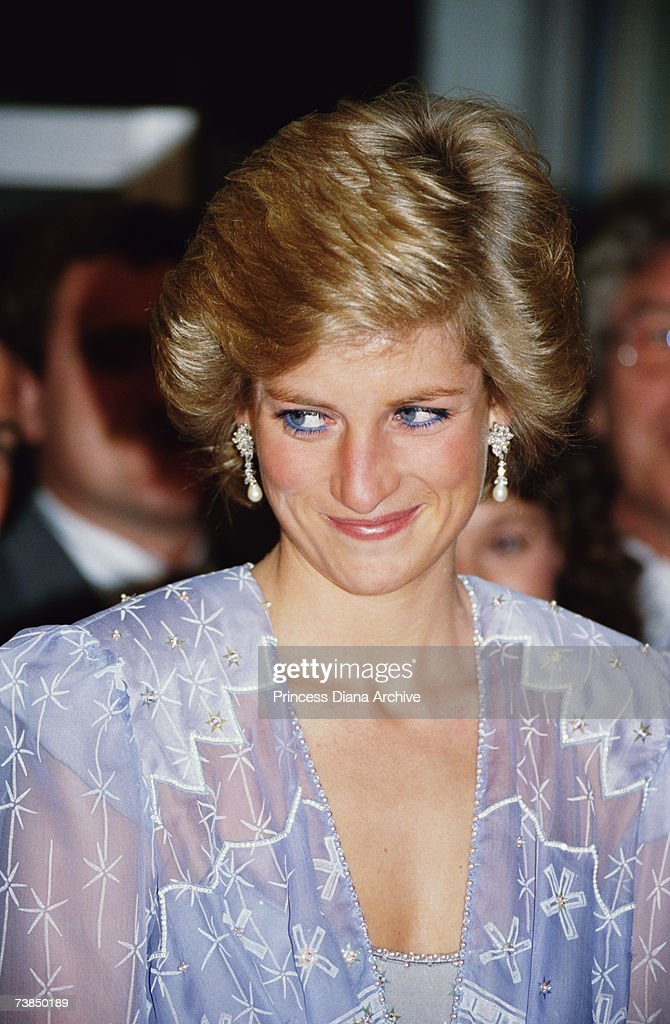 Princess Diana (1961 - 1997) wearing a Zandra Rhodes cocktail dress to a reception at the British Consulate in Dubai, March 1989.