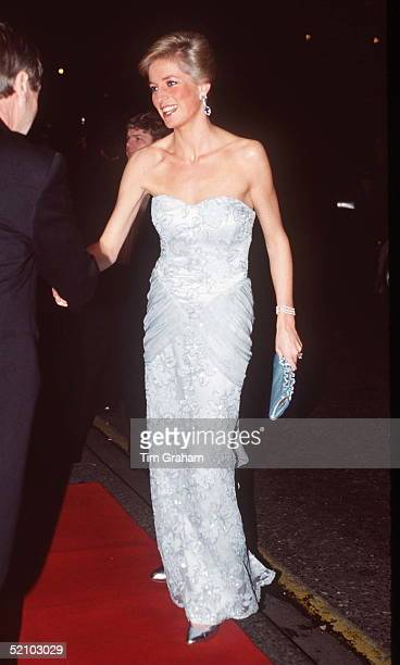 MARCH 09 Princess Diana Wearing An Eggshell Blue Lace Strapless Evening Dress Designed By Catherine Walker To Attend A Moulin Rouge Performance At...