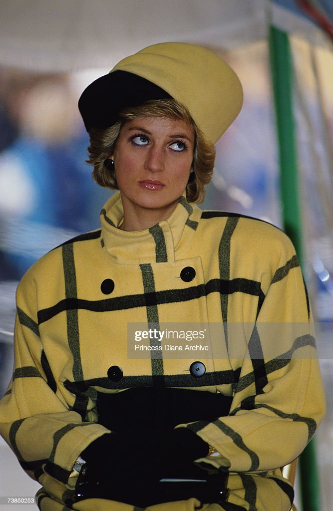 Princess Diana wearing an Escada coat with a hat by Philip Somerville at the naming of the patrol boat Vigilant on the Isle of Wight December 1989