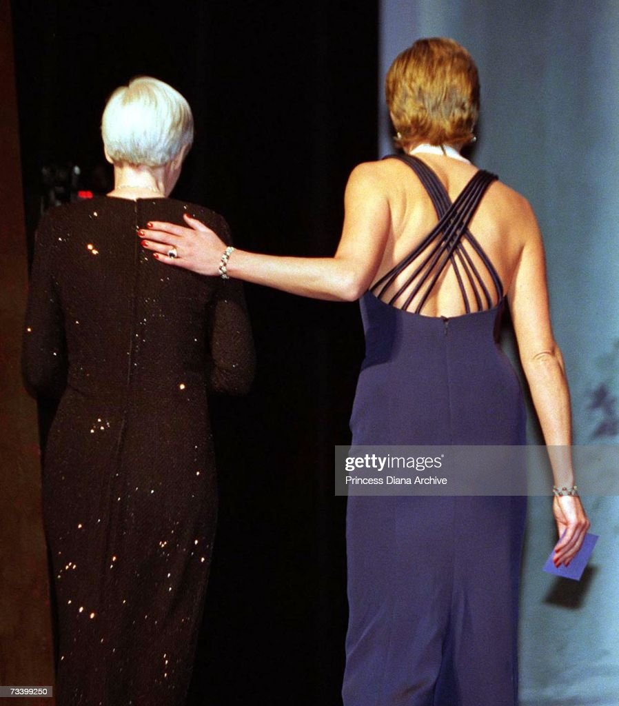 Princess Diana (1961 - 1997) with Harper's Bazaar magazine editor Elizabeth Tilberis (1947 - 1999) at the Fashion Awards at the Lincoln Center, New York, during a two-day visit to the city, January 1995. The princess is wearing a Catherine Walker gown and has her hair slicked back.