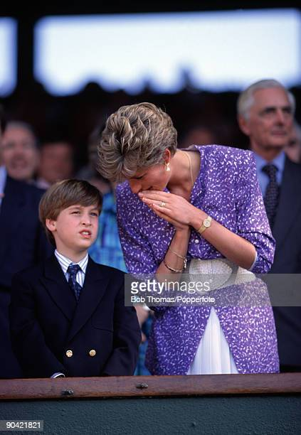 HRH Princess Diana with her son Prince William in the Royal Box on Centre Court at the All England Club during the Wimbledon Lawn Tennis...