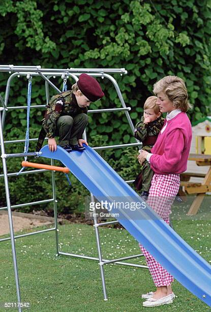 Princess Diana With Her Sons William And Harry As They Play On A Slide In The Grounds Of Highgrove