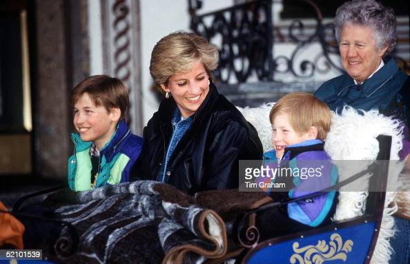 Princess Diana With Prince William And Prince Henry In Lech Austria They Are Sitting In A Carriage With A Blanket Covering Them Sitting Behind Is...