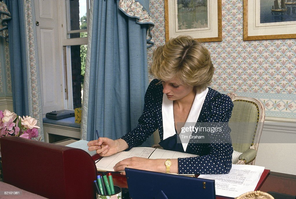 Princess Diana Writing In Her Diary At Her Desk In Her Sitting Room At Home In Kensington Palace, London.