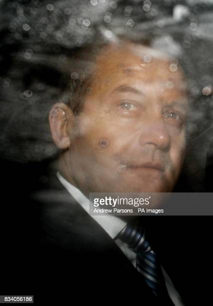 Princess Diana's former butler Paul Burrell leaves the High Court after giving evidence at the inquest into her death