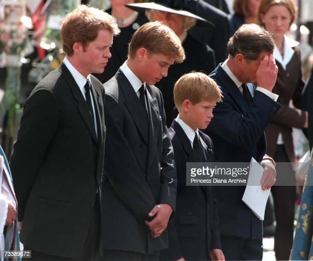 Princess Diana's sons Princes William and Harry with their father Prince Charles and uncle Earl Spencer outside Westminster Abbey on the day of their...