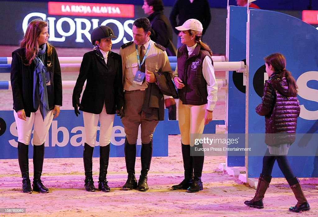 <a gi-track='captionPersonalityLinkClicked' href=/galleries/search?phrase=Princess+Elena+of+Spain&family=editorial&specificpeople=160235 ng-click='$event.stopPropagation()'>Princess Elena of Spain</a> (2R), her daughter <a gi-track='captionPersonalityLinkClicked' href=/galleries/search?phrase=Victoria+Federica&family=editorial&specificpeople=1100859 ng-click='$event.stopPropagation()'>Victoria Federica</a> de Marichalar (R) and Margarita Vargas (L) attend Madrid Horse Week Fair 2012 at Ifema on December 21, 2012 in Madrid, Spain.