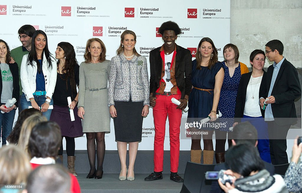 Princess Elena of Spain (C) poses for a group picture during the 'V Premios Jovenes Emprendedores Sociales' of the Universidad Europea de Madrid at The Hub Madrid on March 14, 2013 in Madrid, Spain.