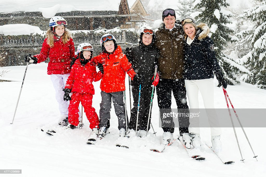 Princess Elisabeth, Princess Eleonore, Prince Emmanuel, Prince Gabriel, King Philippe and <a gi-track='captionPersonalityLinkClicked' href=/galleries/search?phrase=Queen+Mathilde+of+Belgium&family=editorial&specificpeople=239189 ng-click='$event.stopPropagation()'>Queen Mathilde of Belgium</a> pose for a photograph during their winter holidays on March 3, 2014 in Verbier, Switzerland.