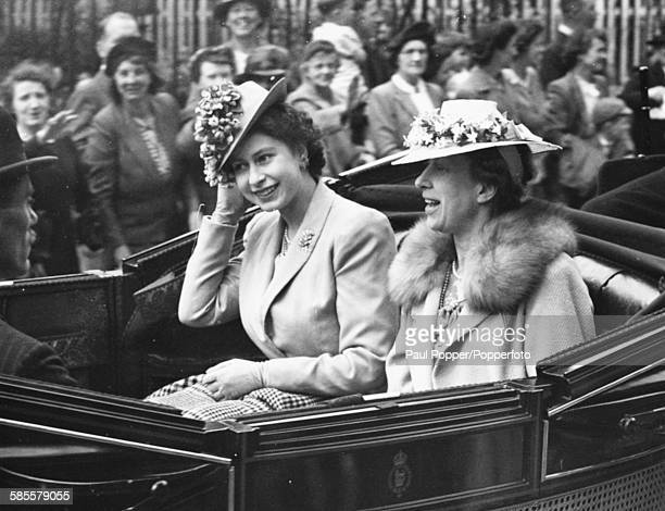 Princess Elizabeth and her aunt Mary Princess Royal ride together in an open carriage to the first Royal Ascot race meeting since World War Two...