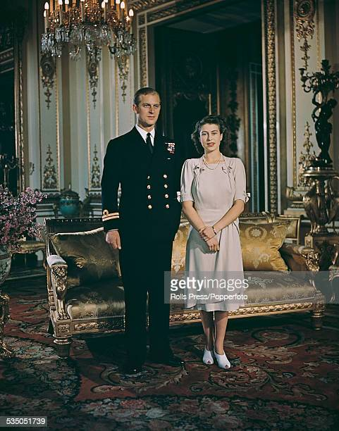 Princess Elizabeth and her betrothed Lieutenant Philip Mountbatten pose together at Buckingham Palace in London after announcing their engagement on...