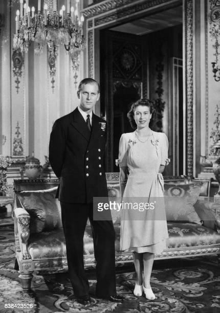 Princess Elizabeth and her Fiance Philip Mountbatten pose in the Buckingham Palace on July 09 1947 in London the day their engagement was officially...