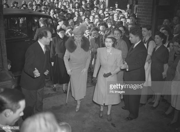 Princess Elizabeth and Her Majesty Queen Mary visit a diamondcutting factory in Clerkenwell London where they will see a workinprogress on cutting a...