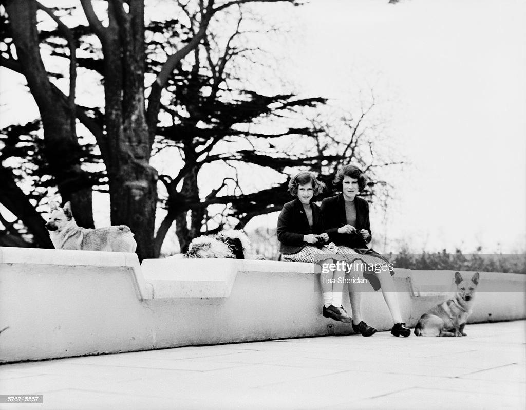Princess Elizabeth and her sister Princess Margaret (1930 - 2002) knitting on the terraces at the back of the Royal Lodge, Windsor, UK, April 1940.