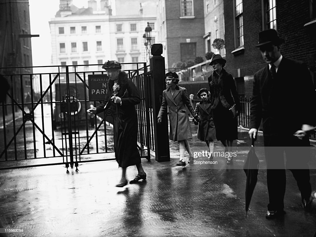 Princess Elizabeth (later Queen Elizabeth II) and her sister Princess Margaret (1930 - 2002) with their nanny, Marion Crawford, leaving the headquarters of the YWCA (Young Women's Christian Association) off Tottenham Court Road, London, 15th May 1939.