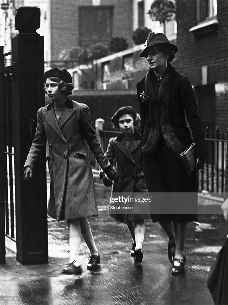 Princess Elizabeth and her sister Princess Margaret (1930 - 2002) with their nanny Miss Marion Crawford leaving the headquarters of the YWCA (Young Women's Christian Association) in London, 15th May 1939.