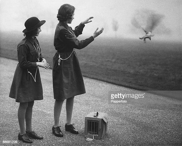 Princess Elizabeth and her younger sister Princess Margaret Rose release a carrier pigeon with a message to Chief Guide Lady Olave BadenPowell on the...