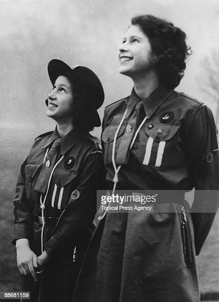 Princess Elizabeth and her younger sister Princess Margaret Rose watching the flight of a carrier pigeon they have just released 20th February 1943...