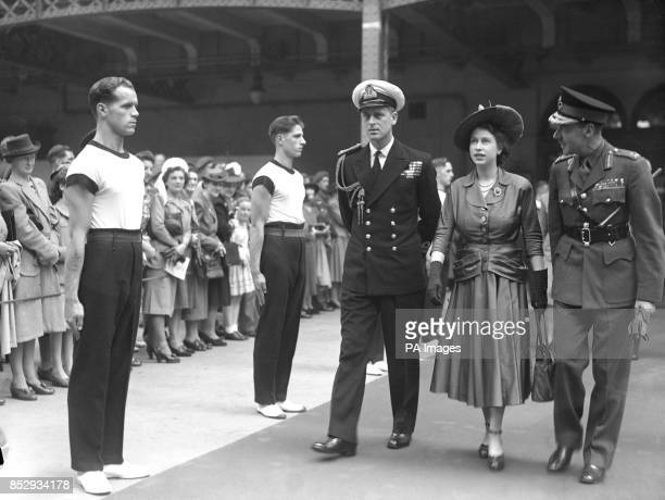 HRH Princess Elizabeth and Lieutenant Philip Mountbatten inspect the PT Guard of Honour at the Royal Tournament at Olympia