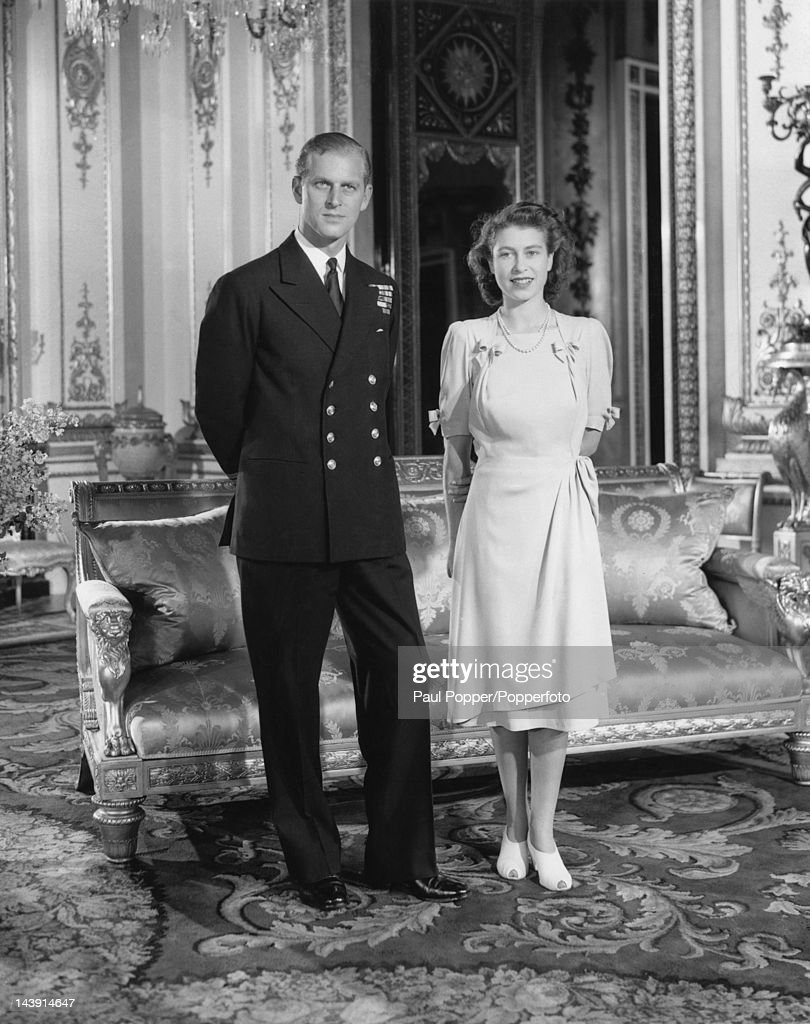 Princess Elizabeth and Lieutenant Philip Mountbatten pose at Buckingham Palace after announcing their engagement, London, 10th July 1947.