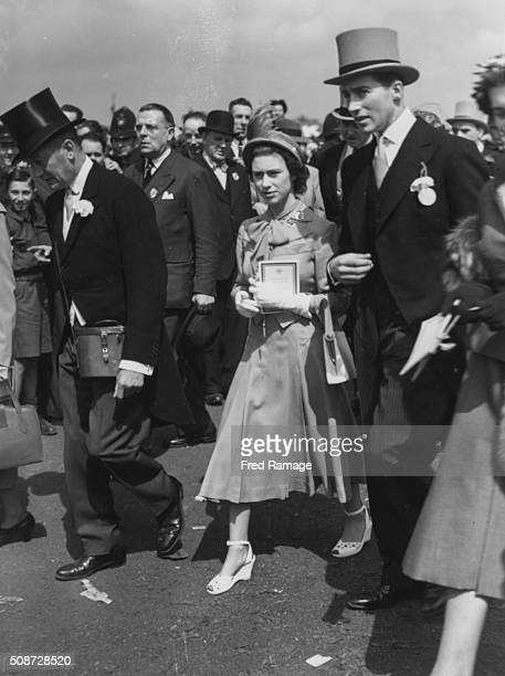 Princess Elizabeth And Lord Porchester walking through the crowd as they attend the Epsom Derby England May 30th 1951