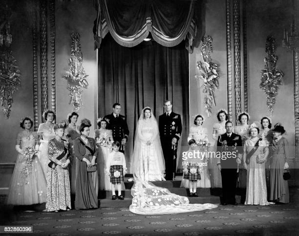 Princess Elizabeth and Lt Philip Mountbatten with close relatives and bridesmaids in the Throne Room at Buckingham Palace immediately ater the...