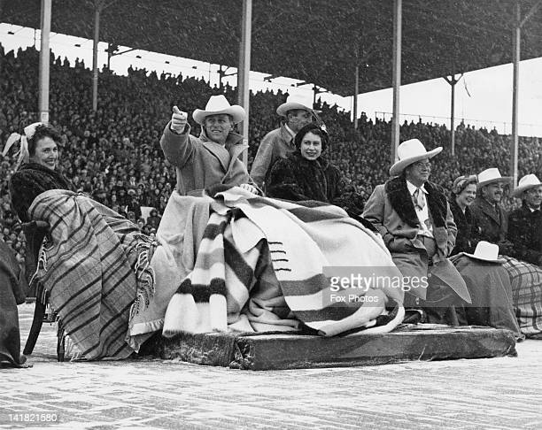Princess Elizabeth and Prince Philip brave a snowstorm to watch a stampede at Calgary exhibition grounds Canada 24th October 1951 Next to the...