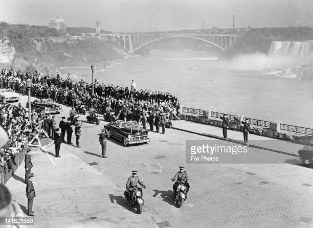 Princess Elizabeth and Prince Philip drive along Park Road on their way past Niagara Falls during their tour of Canada 17th October 1951 The edge of...