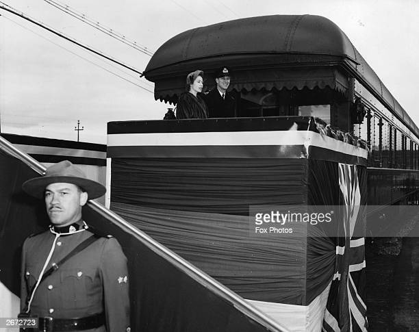 Princess Elizabeth and Prince Philip Duke of Edinburgh on board the Royal Tour Train before leaving Montreal for Quebec during their Royal tour of...