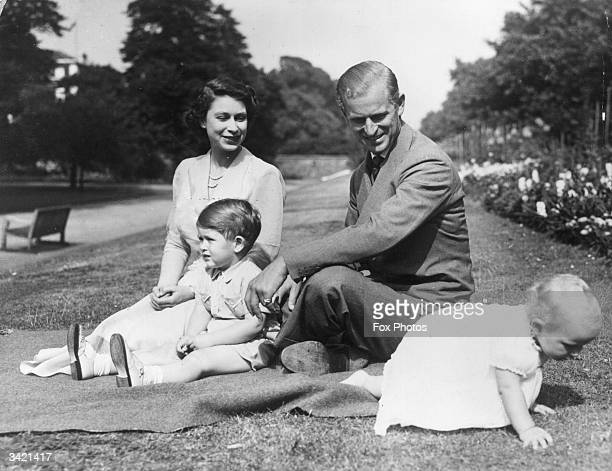 Princess Elizabeth and Prince Philip Duke of Edinburgh with their two children Prince Charles and Princess Anne in the grounds of Clarence House...