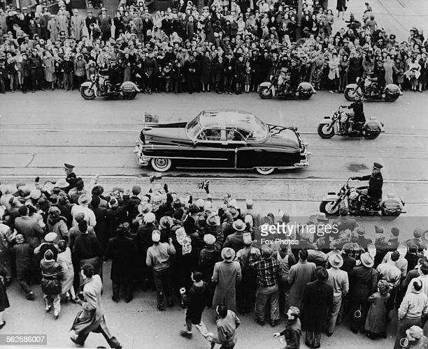 Princess Elizabeth and Prince Philip the Duke of Edinburgh driving through the crowded streets of Winnipeg in a glasstop car during their Royal tour...