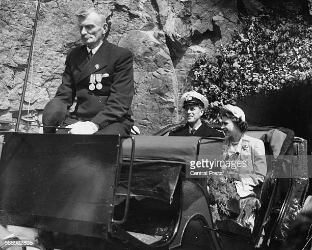 Princess Elizabeth and Prince Philip the Duke of Edinburgh riding in a carriage at they tour the island of Sark Guernsey circa 1948
