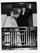 Princess Elizabeth and Prince Philip wave to crowds from the balcony of the royal train after a civic dinner in Saint John New Brunswick during the...