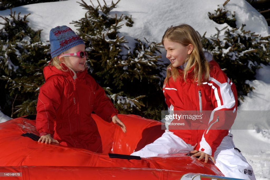 VERBIER , SWITZERLAND - FEBRUARY 22, 2012: Princess Elizabeth (R) and Princess Eleanore (L) play on the ski slopes during the Royal Family Skiing Holiday on February 22,2012 in Verbier,Switzerland.