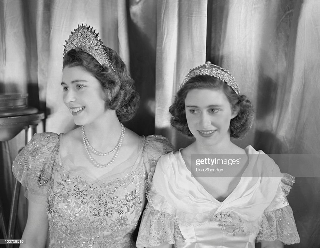 Princess Elizabeth and Princess Margaret both dressed in elaborate gowns pictured during a royal pantomime production of 'Old Mother Red Riding...
