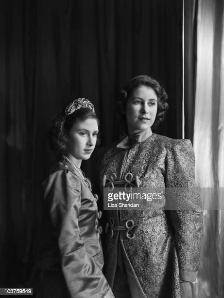 Princess Elizabeth and Princess Margaret both in costume pictured ahead of a royal pantomime production of 'Aladdin' at Windsor Castle Berkshire...
