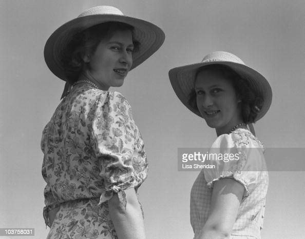 Princess Elizabeth and Princess Margaret both wearing hats pictured in the grounds of Windsor Castle Berkshire Great Britain 30 May 1944