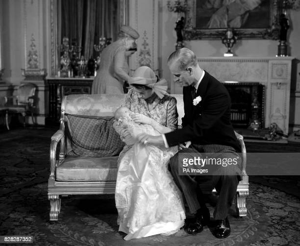Princess Elizabeth and the Duke of Edinburgh console their daughter Princess Anne after the christening at Buckingham Palace London The baby given...