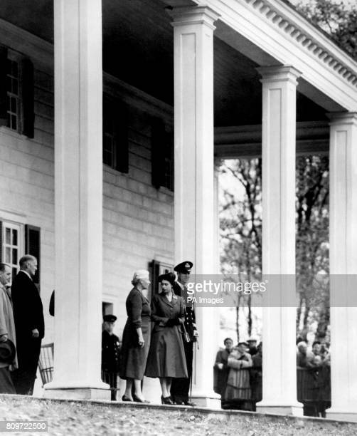 Princess Elizabeth and the Duke of Edinburgh pictured beside the huge pillars that distinguish the facade of George Washington's home in Mount Vernon...