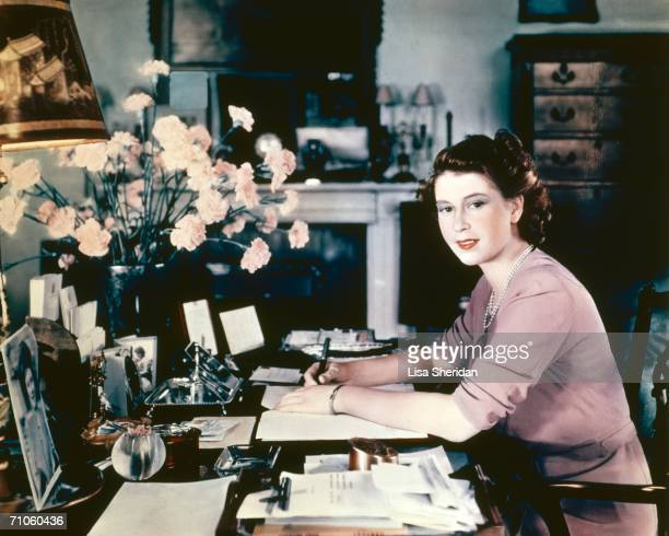 Princess Elizabeth at her desk in her sitting room at Buckingham Palace 19th September 1946